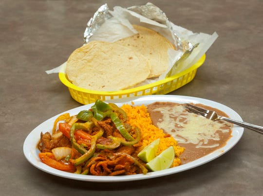 The La Rosita Sol Mexican Taqueria's bistec a la Mexicana is made with beef in a red sauce, mixed with onion and tomatoes and served with Mexican rice, refried beans and corn tortillas.