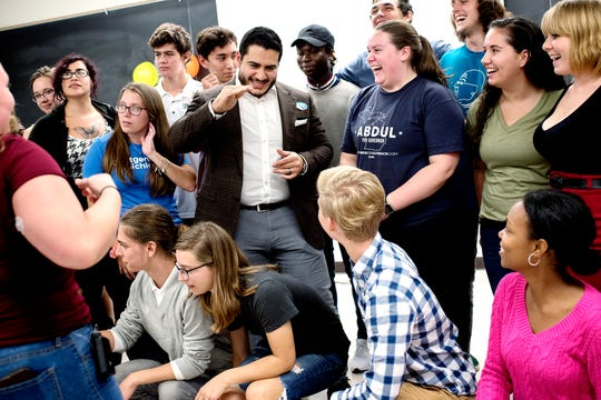 Former gubernatorial candidate Abdul El-Sayed, center, gathers with young people for a group photo after speaking during a NextGen Rising event on National Voter Registration Day at Wells Hall on the Michigan State University campus on Tuesday, Sept. 25, 2018, in East Lansing.