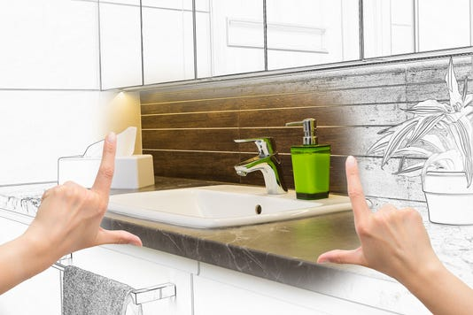 Female Hands Framing Custom Bathroom Design