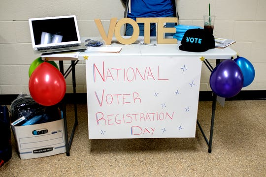 A booth outside a classroom where Former gubernatorial candidate Abdul El-Sayed spoke to a group of young people during a NextGen Rising event on National Voter Registration Day at Wells Hall on the Michigan State University campus on Tuesday, Sept. 25, 2018, in East Lansing.
