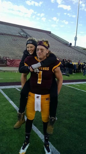 Tony Poljan and sister Becka hang out after a Central Michigan football game in 2017. Becka is now starting for Michigan State's volleyball team.