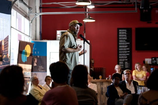 Paul Brogan speaks during the Lansing Storytellers Project: 'Water' event on Tuesday, July 17, 2018, at the Lansing Brewing Company in Lansing.