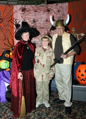 "Colton Wernecke (center) with ""Big Couple"" Betsy (left) and Tom Kocourek at a Halloween party. The ""Bigs"" and ""Little"" were matched through Big Brothers Big Sisters of Manitowoc County."