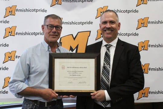 Russ Nowak (left), D & S Machine Service, and PaulOrlich, superintendent for the School District ofMishicot.