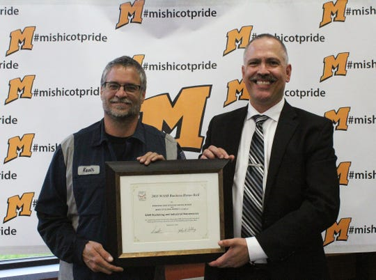 Kevin Krueger (left), KNM, and Paul Orlich, superintendent for the School District of Mishicot.