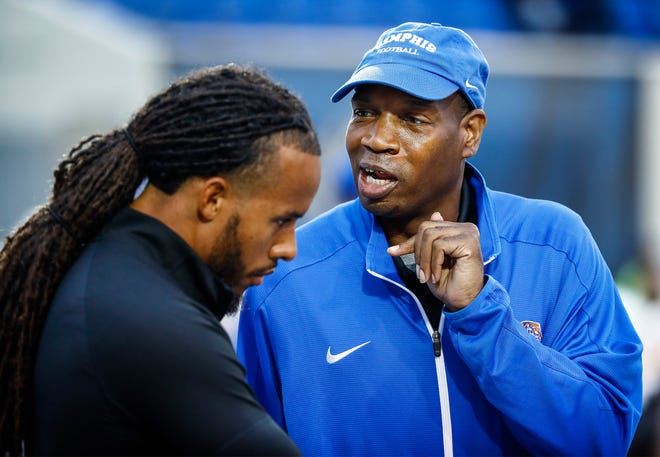 Robert Mitchell (right) a 41-year-old student assistant who began volunteering for the University of Memphis football team in 2016.