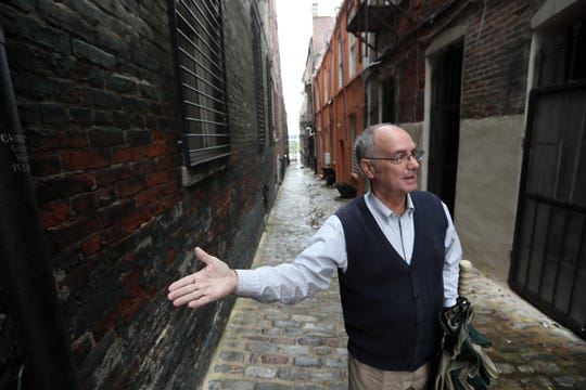 Memphis historian Jimmy Ogle stands in Jack Tucker alley as he talks about the city's downtown landscape.