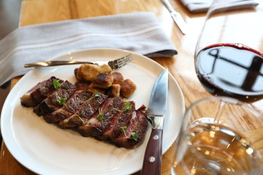 House dry aged strip steak with gnocchi at restaurant P.O. Press Public House and Provisions, set to open its doors to the public in Collierville on October 1, 2018.