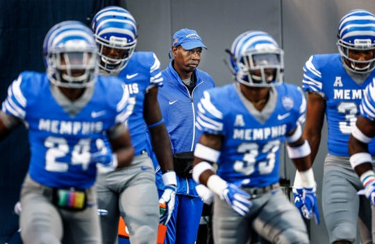 Robert Mitchell (middle) a 41-year-old student assistant who began volunteering for the University of Memphis football team in 2016 after a 15-year stint working with the Stanford football team. He survived a 5-week coma as a 2-year-old after a car accident involving a drunk driver and does all this simply because he loves the game and being around football players.