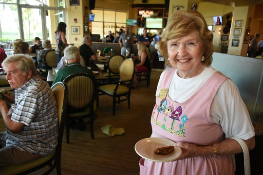Collier County Commissioner Donna Fiala, a member of the group, goes light at the buffet. The East Naples Merchants Association meets monthly, offering networkin and service opportunities.