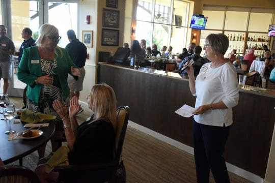 Association president Sandra Simmons speaks to the group at their meeting. The East Naples Merchants Association meets monthly, offering networkin and service opportunities.