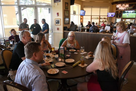 Collier County Commissioner Donna Fiala, right, a member of the group, speaks to the gathering. The East Naples Merchants Association meets monthly, offering networkin and service opportunities.
