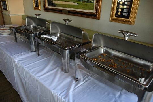 With a high turnout, the buffet offerings at Sam Snead's are wiped out. The East Naples Merchants Association meets monthly, offering networkin and service opportunities.