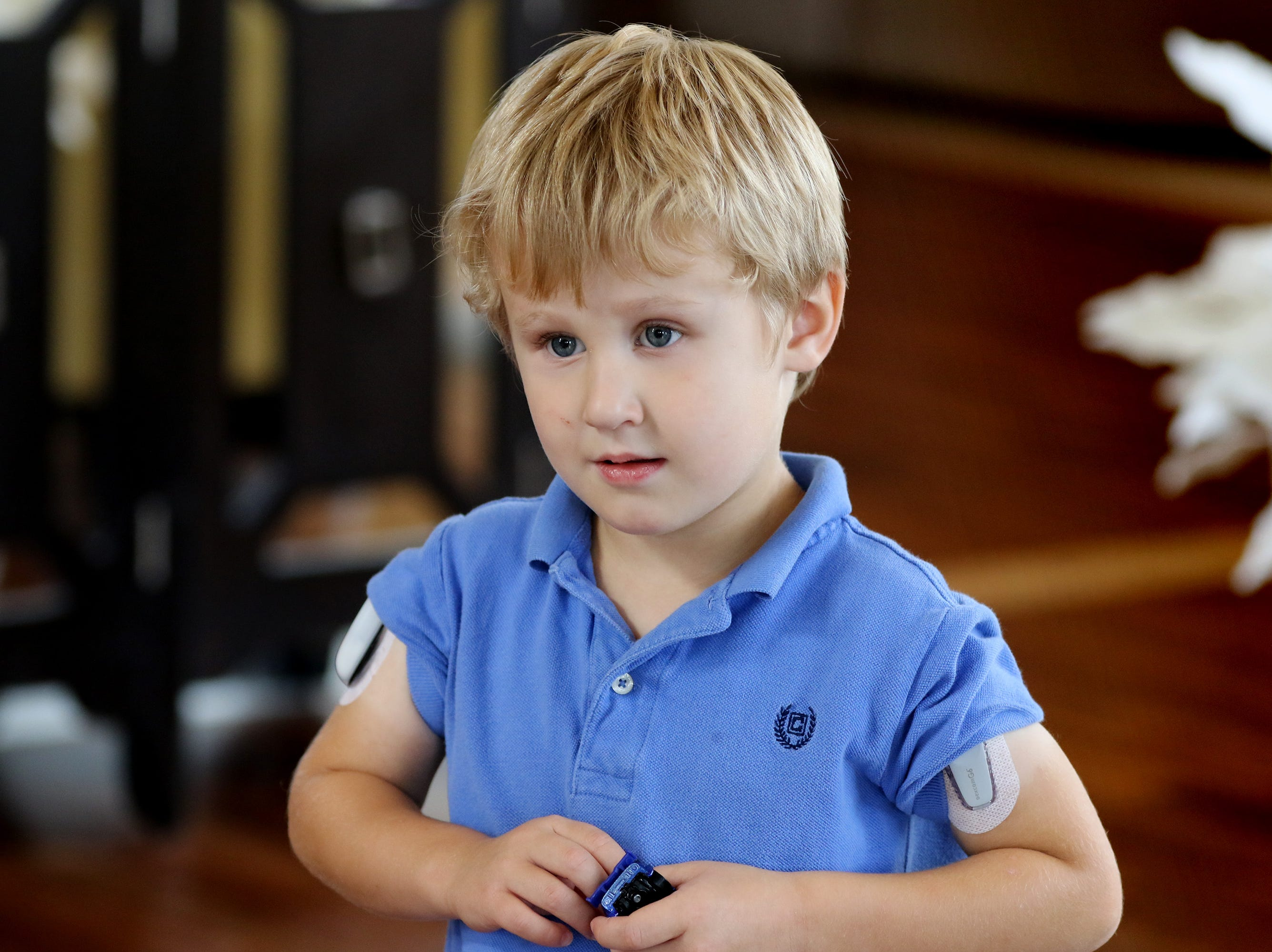 With an insulin pump on his right arm, and a continuous blood glucose monitor on his left arm, Carson Ford goes about his life as an energetic three-year-old with his family in Pewaukee living with Type 1 Diabetes.