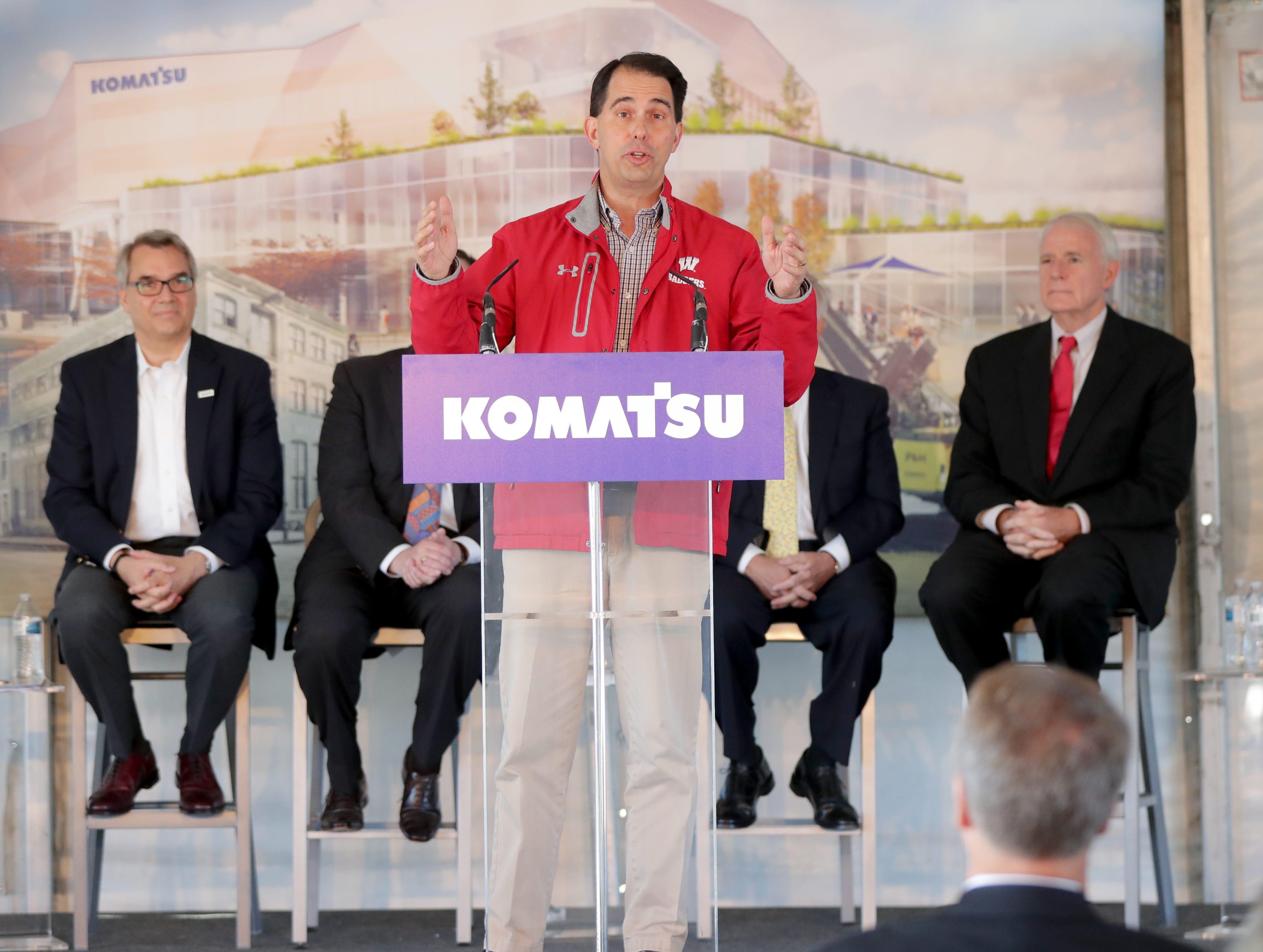 Gov. Scott Walker speaks as Jeff Dawes (left), president and CEO of Komatsu Mining Corp., and Mayor Tom Barrett (right) listen as Komatsu Mining Corp. announced details Thursday of a new development in Milwaukee's Harbor District.