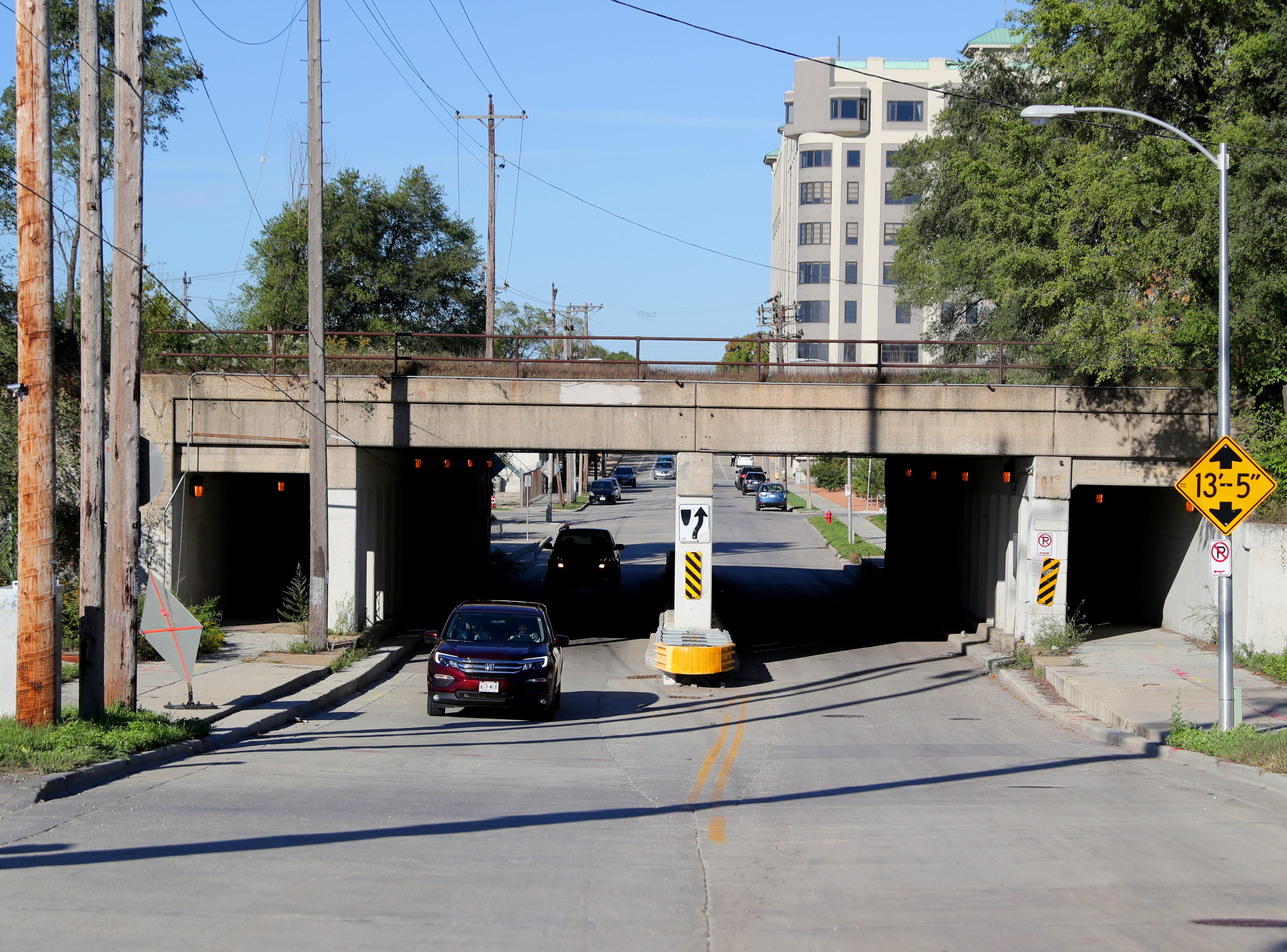 East Greenfield Avenue will have to be lowered under a railroad overpass to allow trucks and equipment to pass through.