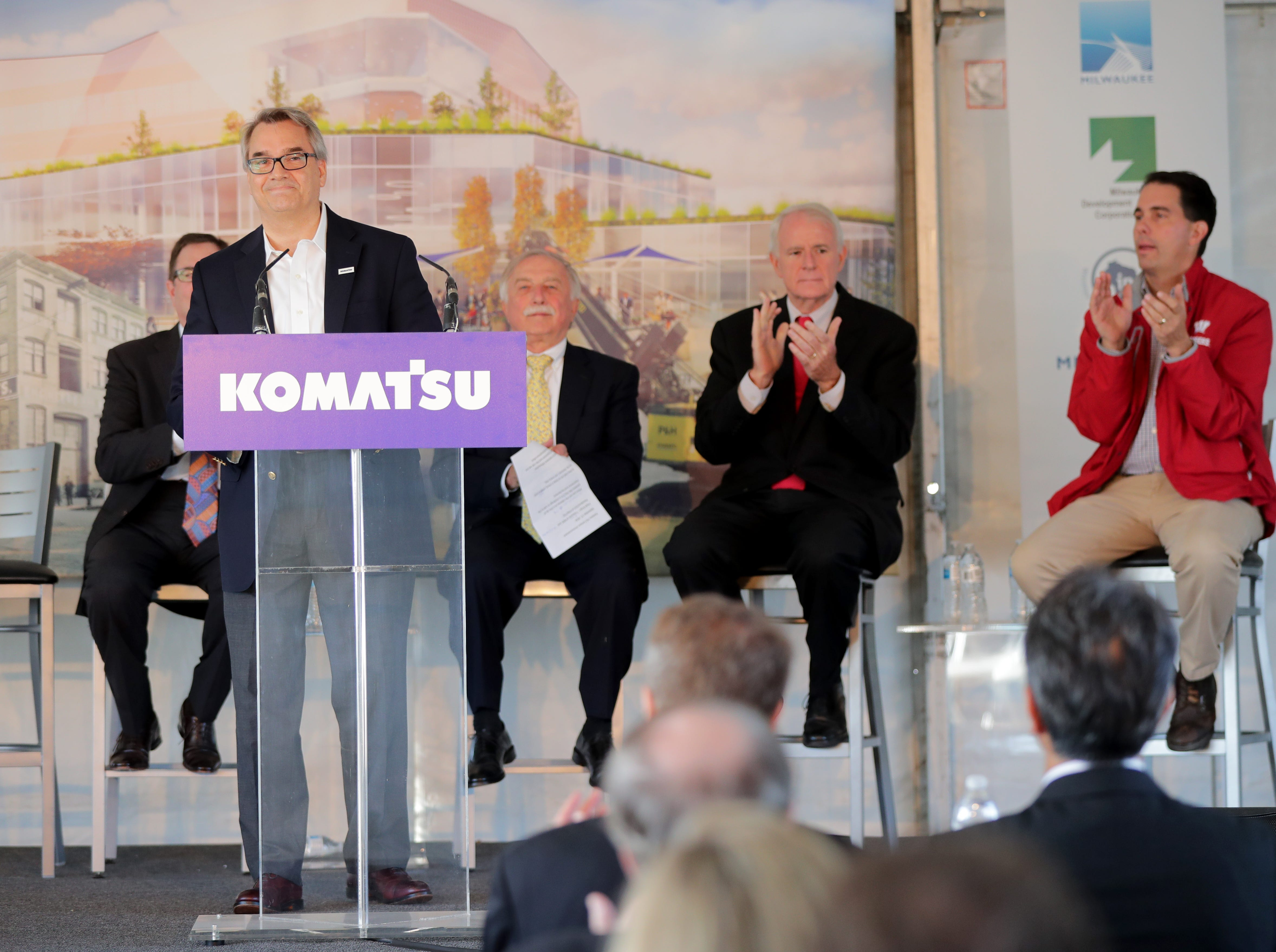 Jeff Dawes, president and CEO of Komatsu Mining Corp., is applauded after making the announcement that Komatsu Mining's $285 million Harbor District offices and factories will eventually total 1,000 jobs.