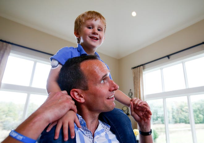 Carson Ford, 3, smiles with his dad, John Ford, at their Pewaukee home. Carson has Type 1 diabetes.