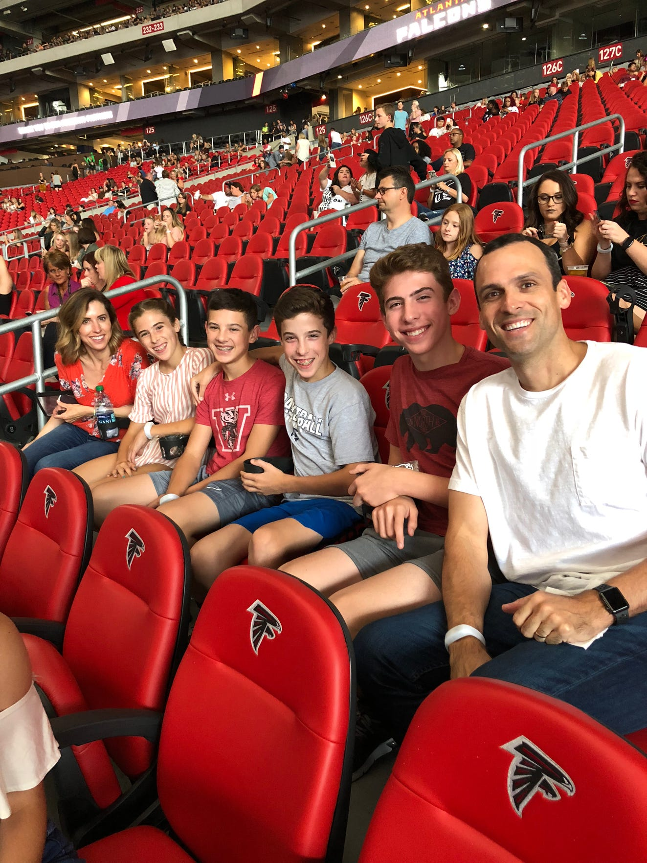 Former Pius XI standout Mike Kelley (far right) and Kelly (Auger) Kelley (far left) are seated with their children, from left to right, Shae (12), Sean (13), Ty (13) and Mike (14).