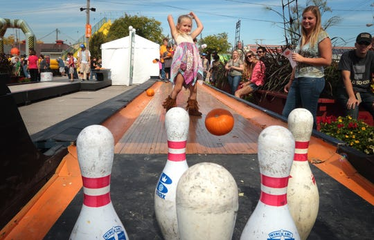 Pumpkin bowling is just one of the attractions at the Harvest Fair at State Fair Park. Admission to the fair is free.