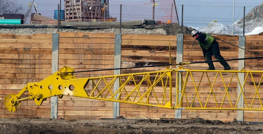 A crane owned by Michels Construction being assembled near I-94 westbound at 84th St. as part of the Zoo interchange project in Milwaukee January 23, 2015.
