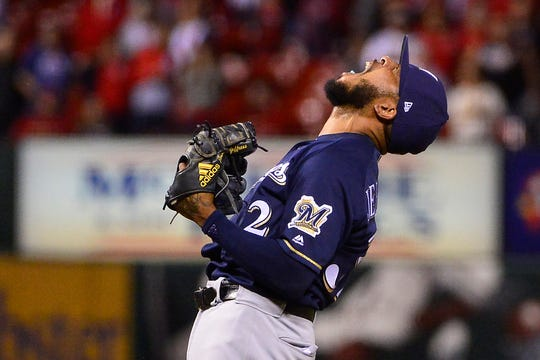 Jeremy Jeffress lets out a scream of joy after the Brewers clinch a playoff spot Wednesday night