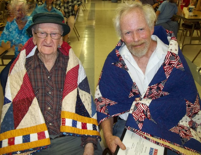 Daniel Richards (left), USMC, served in World War II and made landings at Iwo Jima, Guadacanaland Saipan, and was wounded during each battle.Richardsis 102 years old.Tommy McFarland, U.S. Army, retired, served from 1973 to 2000, serving in multiple locations and Desert Storm.Both veterans were awarded Quilts of Valor by the Mountain Home Quilts of Valor Group at the Cotter VFW during a gathering of family and friends.