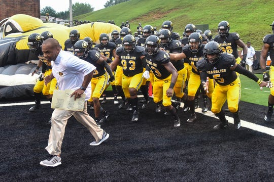 Grambling State head football coach Broderick Fobbs leads his team onto the field versus Alabama State at Eddie G. Robinson Memorial Stadium Saturday, Sept. 22, 2018.