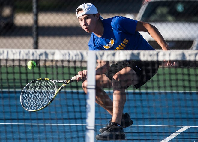 Burris' Nate Yang hits against Central's Tyler Walker during their match at Delta High School Wednesday, Sept. 26, 2018.