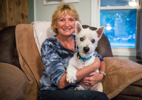 Casey, a 13-year-old westie, sits with her owner Sherry Richardson as she talks about the dogs battle with cancer. Casey has had her front left amputated after a battle with bone cancer, but is now facing lung cancer as well.