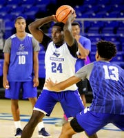 MTSU 's Darnell Butler Jr (24) passes the ball as Anthony Crump (13) guards him during the Mens Basketball team's first open practice at Murphy Center, on Wednesday, Sept. 26, 2018.