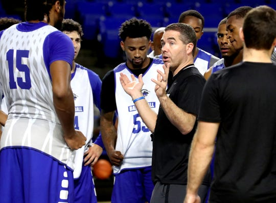 MTSU's mens basketball head coach Nick McDevitt, works with his players during their first open practice at Murphy Center, on Wednesday, Sept. 26, 2018.