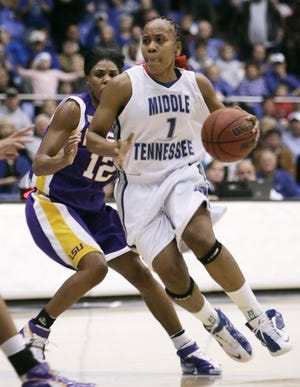 Middle Tennessee guard Amber Holt (1) drives past LSU's Rashonta LeBlanc (12) during the first half of a basketball game in Murfreesboro, Tenn., Friday, Dec. 28, 2007. Holt scored 41 points to help Middle Tennessee upset LSU 67-56. (AP Photo/Mark Humphrey)