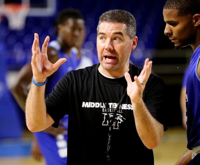 MTSU men's basketball coach Nick McDevitt works with his players during their first official practice Wednesday at Murphy Center.
