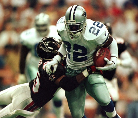 Dallas Cowboys running back Emmitt Smith (22) is tackled by Atlanta Falcons safety Marty Carter in the first quarter Monday, Sept. 20, 1999 in Irving, Texas.  -(AP Photo/Vern Steinman)