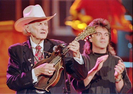 Bill Monroe, left, the Father of Bluegrass Music, performs with Marty Stuart in the 1990s.
