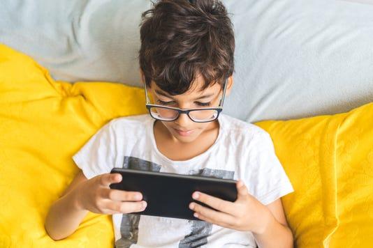 Boy With Digital Tablet On Sofa