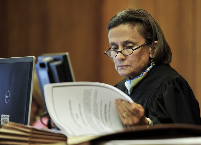 Chancellor Claudia Bonnyman looks over evidence during a trial in 2015 in Nashville.
