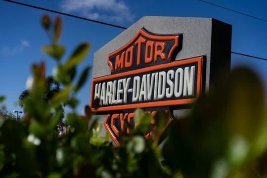 The morning sun illuminates the Naples Harley Davidson sign during the last few days of the shop's location at Naples. On Saturday, September 29, 2018, the shop will consolidate with Six Bends Harley-Davidson at Fort Myers.
