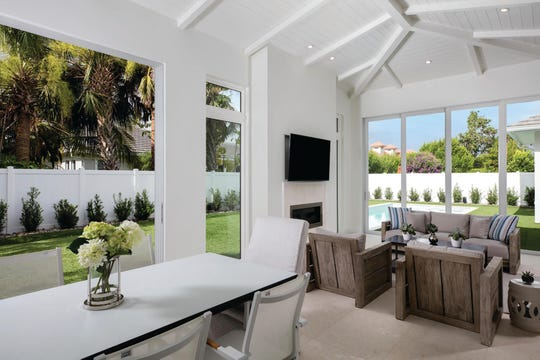 This private residence in The Moorings won a Sand Dollar Award for Best Specialty Feature. The lanai can be opened up as outdoor living space or as closed space.