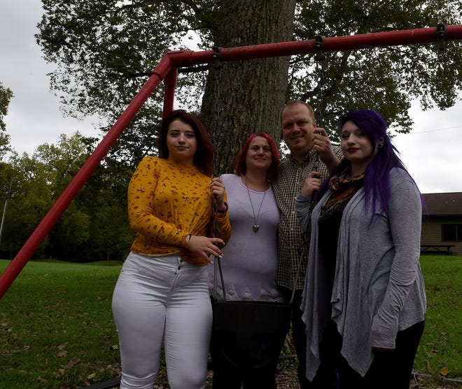 Matthew and Heather Offers (center) with daughters Dawn Giglio, 17, and Crystal Giglio, 20, at the Hoback park swing sets, one of the favorite spots of Matthew Offers Jr. Matthew, a second-grader from Heath, died recently after a struggling with a congenital heart defect his whole life.