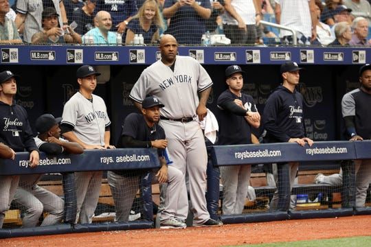 New York Yankees starting pitcher CC Sabathia (52) looks on from the dugout after he got ejected from the game during the sixth inning against the Tampa Bay Rays  at Tropicana Field.