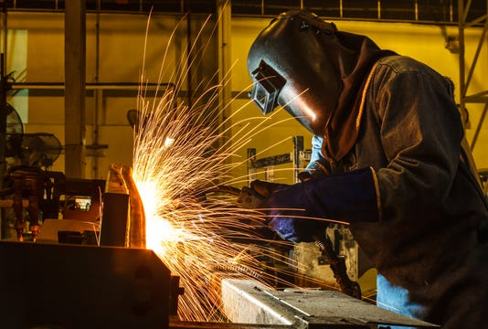 Welder Welding Automotive Part In A Car Factory