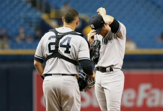 Sep 26, 2018; St. Petersburg, FL, USA; New York Yankees relief pitcher David Robertson (30) reacts as catcher Gary Sanchez (24) comes to the mound to talk during the eighth inning against the Tampa Bay Rays at Tropicana Field.