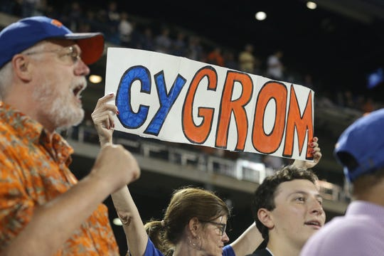 Sep 26, 2018; New York City, NY, USA; A fan holds a sign referring to New York Mets starting pitcher Jacob deGrom (not pictured) during the seventh inning against the Atlanta Braves at Citi Field. Mandatory Credit: Brad Penner-USA TODAY Sports