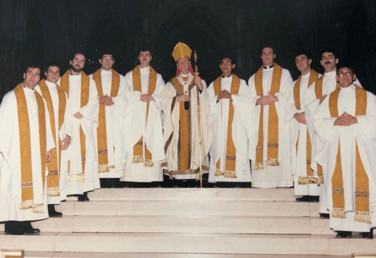 McCarrick with Reading's class after the ordination ceremony