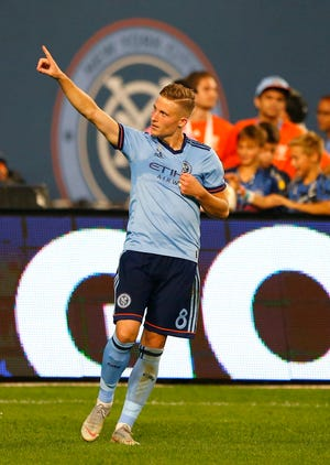 Sep 26, 2018; New York, NY, USA; New York City midfielder Alexander Ring (8) reacts after scoring a goal against the Chicago Fire during the second half at Yankee Stadium. Mandatory Credit: Noah K. Murray-USA TODAY Sports