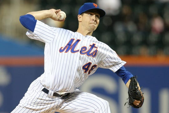 New York Mets starting pitcher Jacob deGrom (48) pitches against the Atlanta Braves during the first inning at Citi Field.