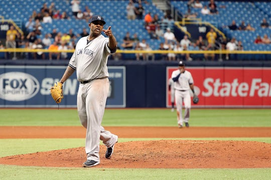 Sep 27, 2018; St. Petersburg, FL, USA; New York Yankees starting pitcher CC Sabathia (52) reacts and points to the Tampa Bay Rays dugout as he hits catcher Jesus Sucre (45) (not pictured) by a pitch and gets ejected from the game during the sixth inning at Tropicana Field.
