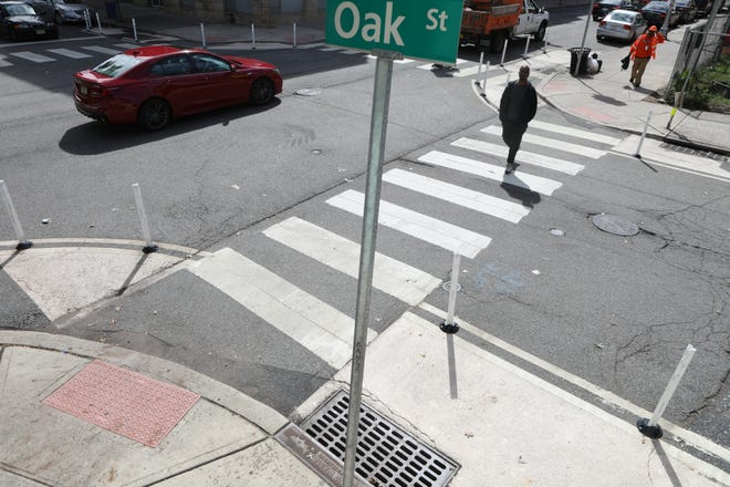 The intersection of Oak St. and Martin Luther King Dr. in Jersey City has curb extensions to increase pedestrian visibility, force drivers to slow down and reduce the crossing distance for pedestrians.